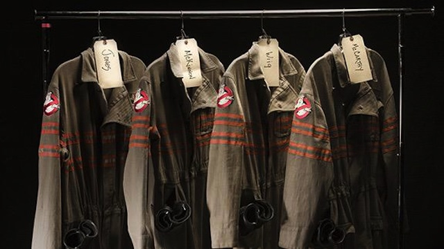 The Ghostbusters costumes from the upcoming reboot are here! Look at what Kristen Wiig, Kate McKinnon, Melissa McCarthy and Leslie Jones will be wearing.
