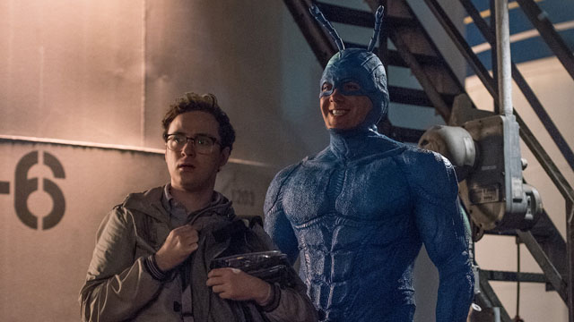 Amazon Studios has just released more than a dozen new photos from their upcoming live action The Tick series, starring Peter Serafinowicz as the Tick.