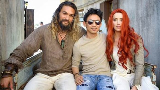 Amber Heard has shared a photo of herself, Jason Momoa and director James Wan on the Aquaman movie set. The DC Comics film is now in production.