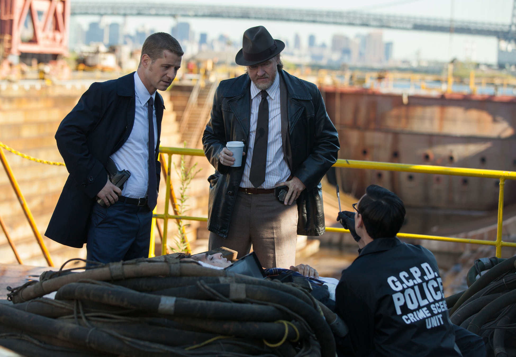"""GOTHAM: Edward Nygma (Cory Michael Smith, R) and Detectives James Gordon (Ben McKenzie, L) and Harvey Bullock (Donal Logue, C) examine a crime scene in the """"The Mask"""" episode of GOTHAM airing Monday, Nov. 10 (8:00-9:00 PM ET/PT) on FOX. ©2014 Fox Broadcasting Co. Cr: Jessica Miglio/FOX"""