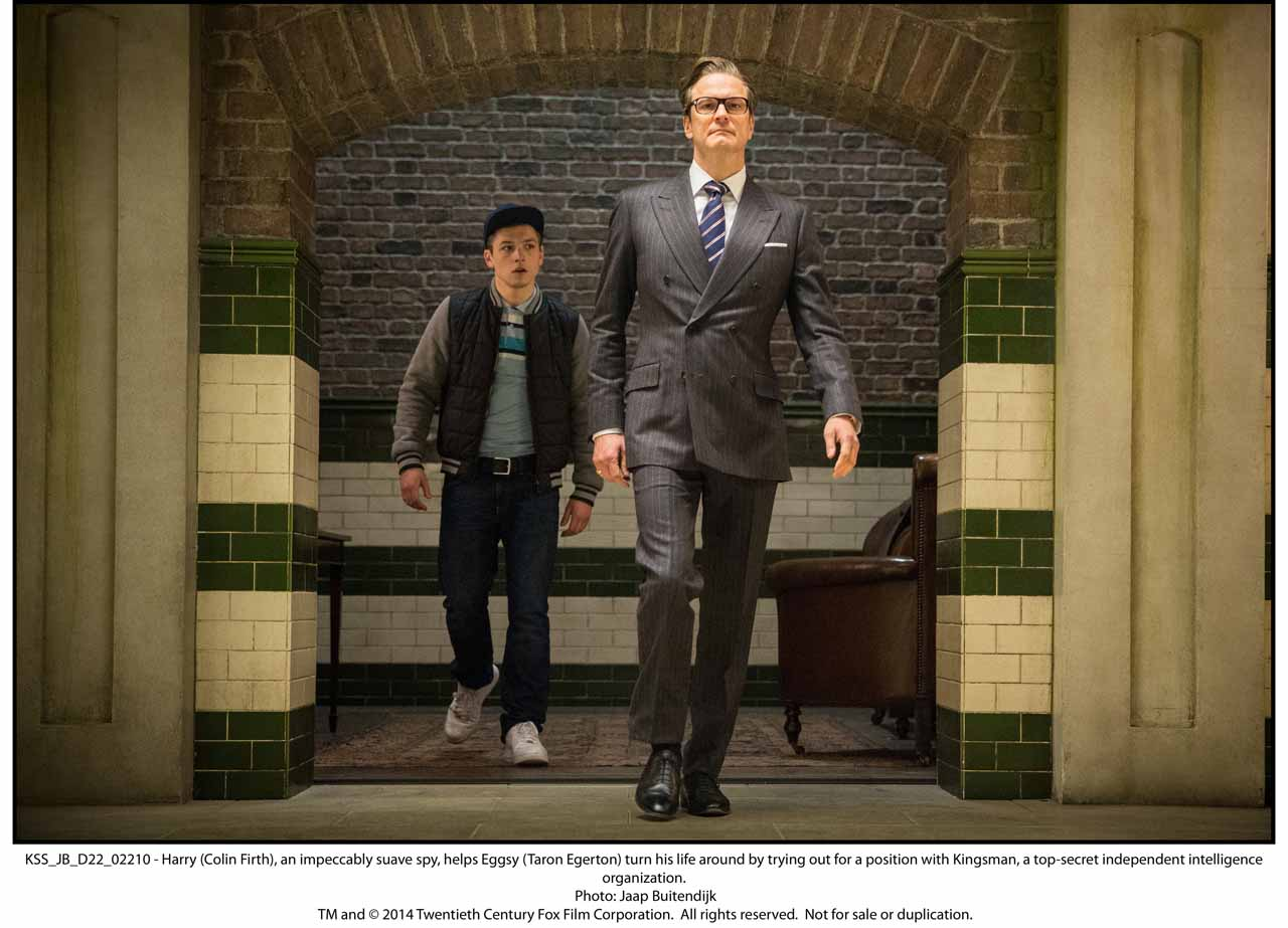 KSS_JB_D22_02210 - Harry (Colin Firth), an impeccably suave spy, helps Eggsy (Taron Egerton) turn his life around by trying out for a position with Kingsman, a top-secret independent intelligence organization.
