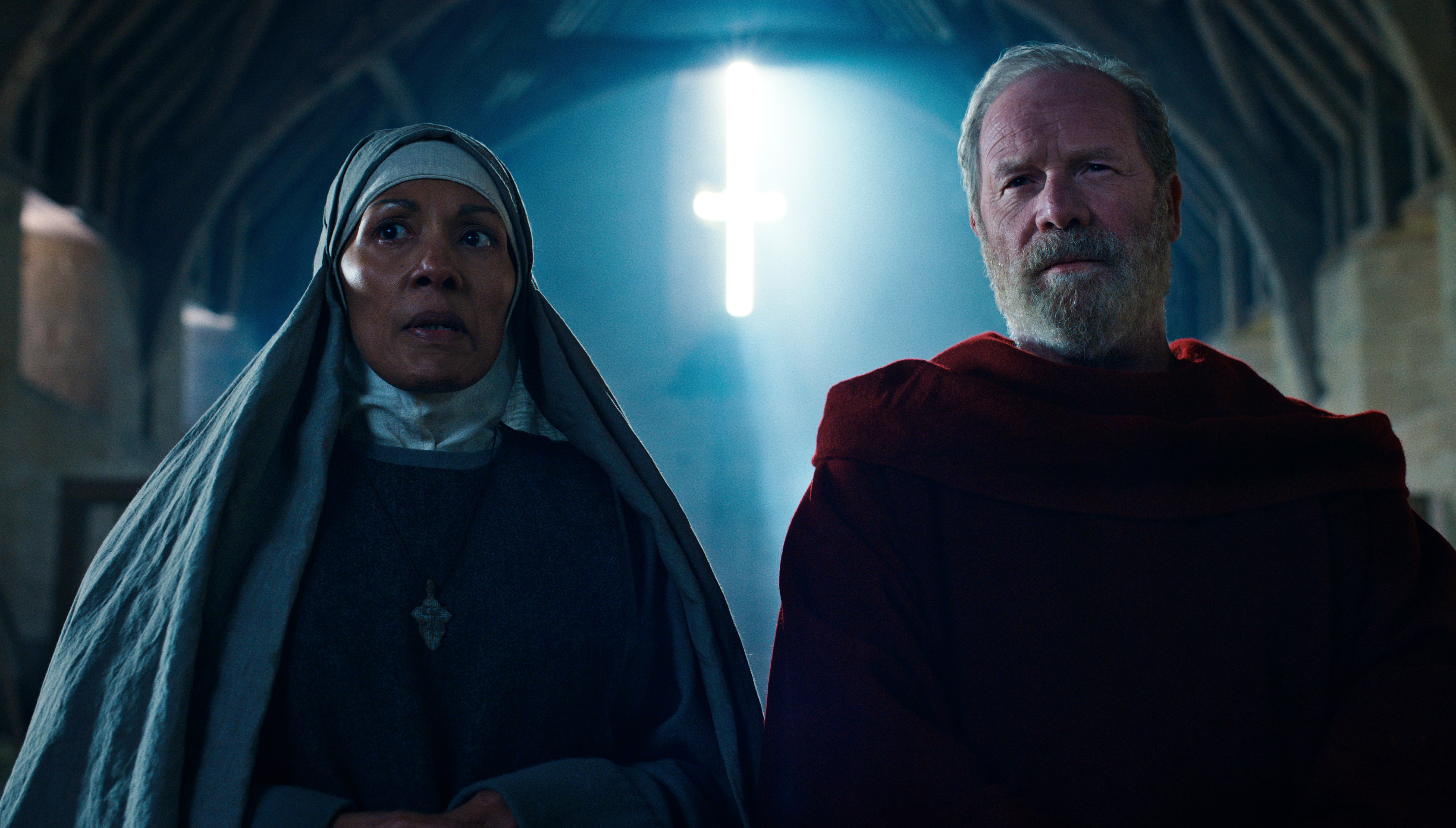 CAROLINE LEE JOHNSON as ABBESS NORA and PETER MULLAN as FATHER CARDEN